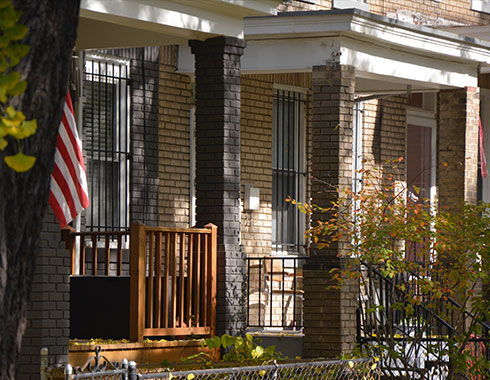 American home. American flag. Front steps.