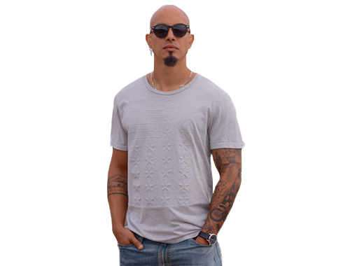 Strong man with tattoos in glasses. Photography.