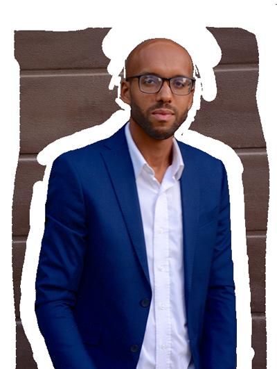 Bearded man with glasses in blue blazer. Filmmaker and website designer.