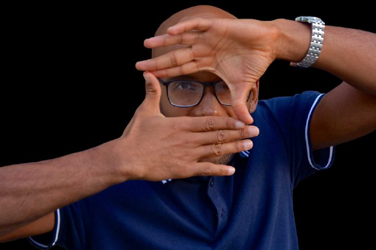 Man with watch. Man in blue Polo shirt. Filmmaker and director.