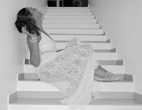 Women in White dress. Stairway. Black and white photo. Photography.