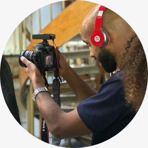 DSLR camera. Headphones. Music video.