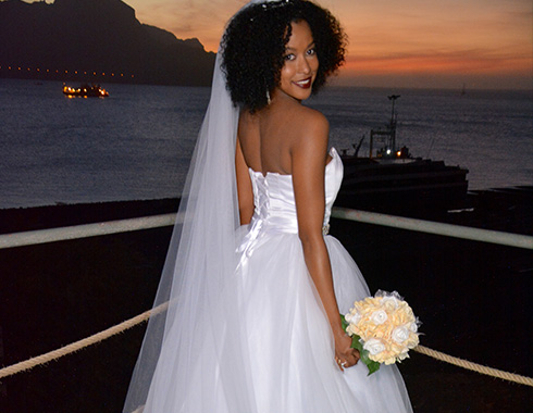 Bride. Newly married. Ocean at night. Photography.