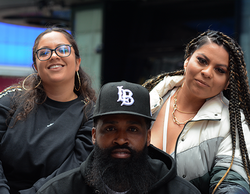 Bearded man and two women. Manhattan, NYC. Photography.