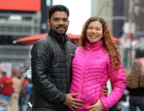 Man and pregnant woman. Manhattan, NYC. Photography.