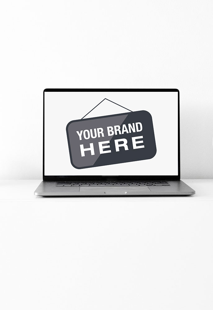 Laptop displaying words Your Brand Here. Website design.